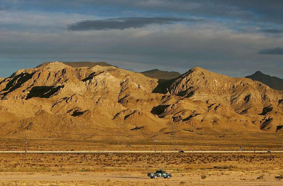 As the sun comes up in the Nevada desert, an autonomous vehicle built by Team DAD from Morgan Hill makes its way down the road in 2005. The Defense Advanced Research Projects Agency sponsored a self-driving car competition, the DARPA Grand Challenge, that year. Photo: KURT ROGERS, SFC
