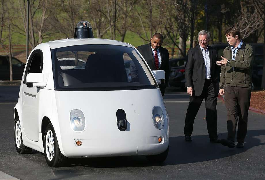Google's Chris Urmson (right) shows a Google self-driving car to U.S. Transportation Secretary Anthony Foxx (left) and Google Chairman Eric Schmidt at the Google headquarters in Mountain View in 2015. Urmson now runs his own self-driving tech startup. Photo: Justin Sullivan, Getty Images