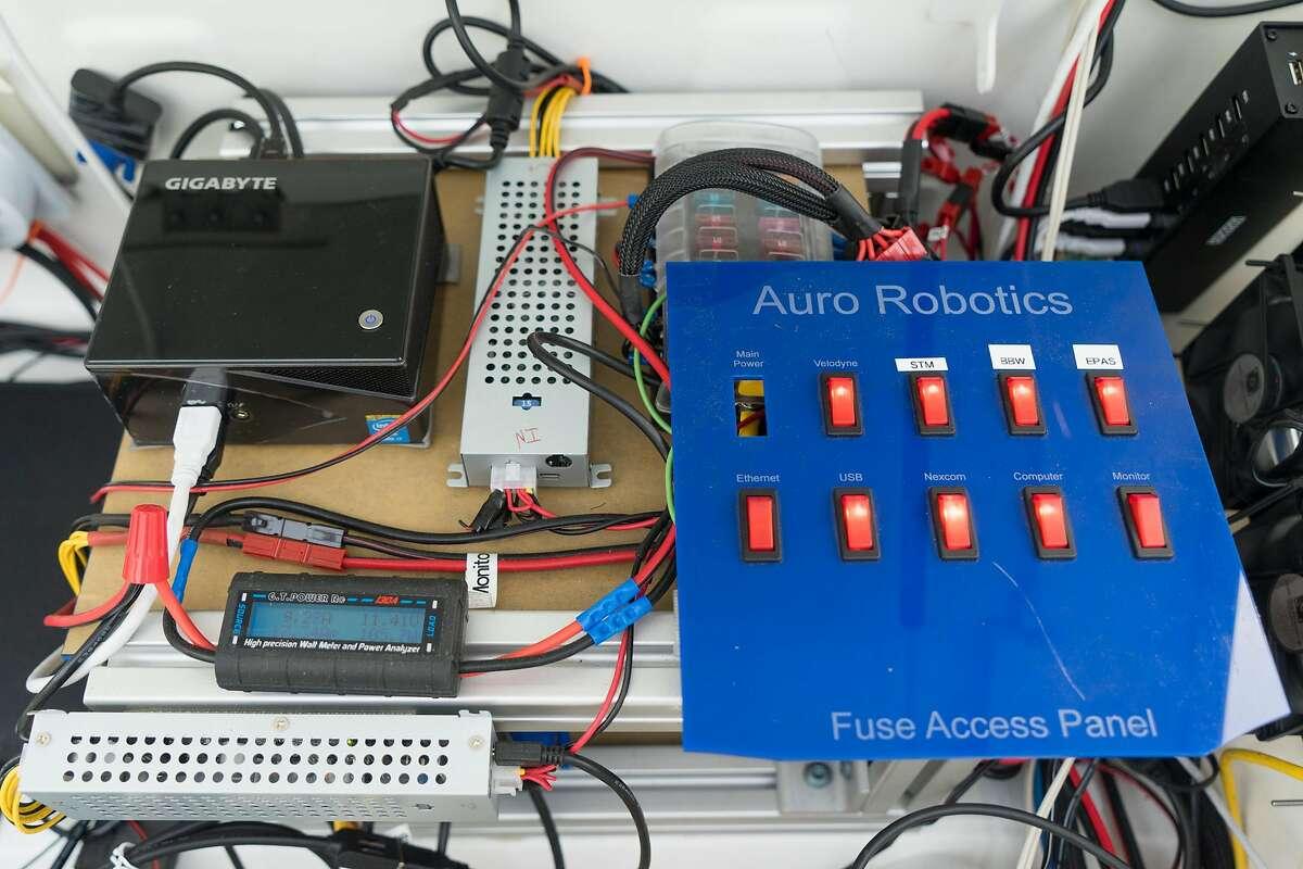 Computer parts are seen inside a self driving car in Santa Clara, Calif. on Thursday, Dec. 8, 2016. Auro Robotics is testing driverless shuttles at Santa Clara University that can take three people around campus.