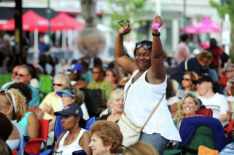 Donna Aekins, of Norwalk, dances to opening act Robbie Jenkins during the summer's first Wednesday Nite Live concert, which featured Dionne Warwick, in Columbus Park in downtown Stamford, Conn. on Wednesday, July 12, 2017. Photo: Michael Cummo, Hearst Connecticut Media / Stamford Advocate