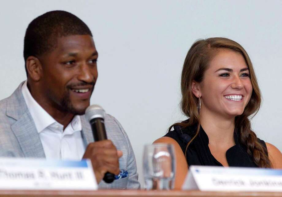 "Local athletic trainer Derrick Jonkins, left, shares a laugh with Kassidy Cook, Olympic diver and 2013 graduate of The Woodlands High School, during a sports forum titled ""Going Pro"" at The Woodlands Country Club, Wednesday, July 12, 2017, in The Woodlands. The 10-person panel comprised of athletes, health care providers and others from the sports industry offered advice and answered questions about college recruitment and competing at the professional level. Photo: Jason Fochtman, Staff Photographer / © 2017 Houston Chronicle"