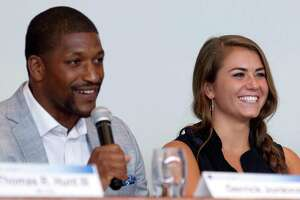 """Local athletic trainer Derrick Jonkins, left, shares a laugh with Kassidy Cook, Olympic diver and 2013 graduate of The Woodlands High School, during a sports forum titled """"Going Pro"""" at The Woodlands Country Club, Wednesday, July 12, 2017, in The Woodlands. The 10-person panel comprised of athletes, health care providers and others from the sports industry offered advice and answered questions about college recruitment and competing at the professional level."""