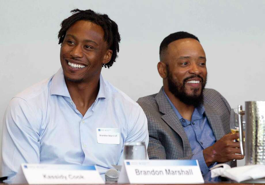 "Brandon Marshall, NFL wide receiver with the New York Giants, shares a laugh beside Santana Moss, former NFL wide receiver with the New York Jets and Washington Redskins, during a sports forum titled ""Going Pro"" at The Woodlands Country Club, Wednesday, July 12, 2017, in The Woodlands. The 10-person panel comprised of athletes, health care providers and others from the sports industry offered advice and answered questions about college recruitment and competing at the professional level. Photo: Jason Fochtman, Staff Photographer / © 2017 Houston Chronicle"
