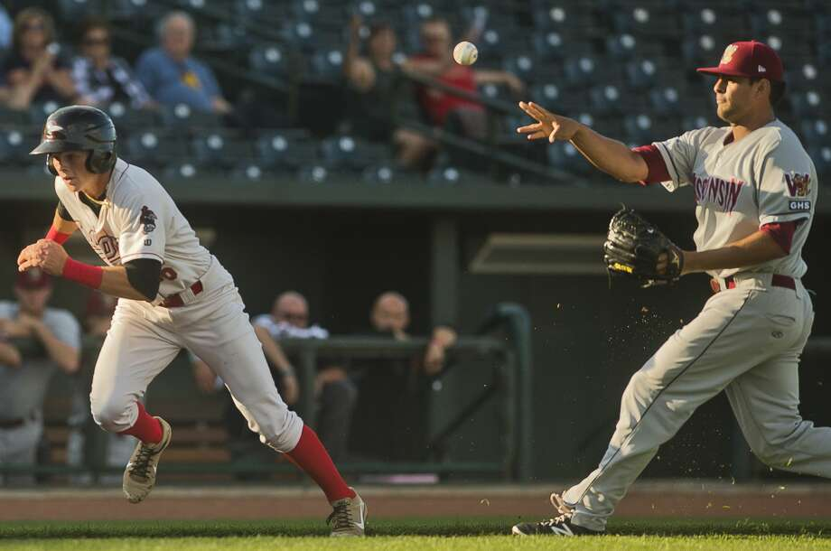 Loons shortstop Gavin Lux sprints toward home as Wisconsin pitcher Victor Diaz throws the ball home to try to get him out during the Loons' game against the Wisconsin Timber Rattlers on Wednesday. Photo: (Katy Kildee/kkildee@mdn.net)