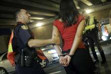 MIAMI - DECEMBER 15: Officer Kevin Millan from the City of Miami Beach police department arrests a woman after she failed a field sobriety test at a DUI checkpoint December 15, 2006 in Miami, Florida. According to police, the woman failed a breathalyzer test by blowing into the device and receiving two readings one at .190 the other .183, which is twice the legal limit in Florida. The city of Miami, with the help of other police departments, will be conducting saturation patrols and setting up checkpoints during the holiday period looking to apprehend drivers for impaired driving and other traffic violations. (Photo by Joe Raedle/Getty Images)