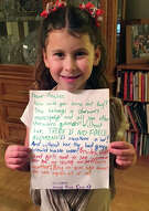 """Annie Rose Goldman holds a letter that she wrote to Hasbro asking why the female character Rey was omitted from a Monopoly set based on """"Star Wars."""""""