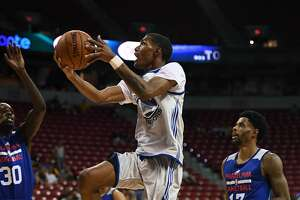 LAS VEGAS, NV - JULY 08:  Patrick McCaw #0 of the Golden State Warriors drives to the basket against the Philadelphia 76ers during the 2017 Summer League at the Thomas & Mack Center on July 8, 2017 in Las Vegas, Nevada. Philadelphia won 95-93. NOTE TO USER: User expressly acknowledges and agrees that, by downloading and or using this photograph, User is consenting to the terms and conditions of the Getty Images License Agreement.  (Photo by Ethan Miller/Getty Images)