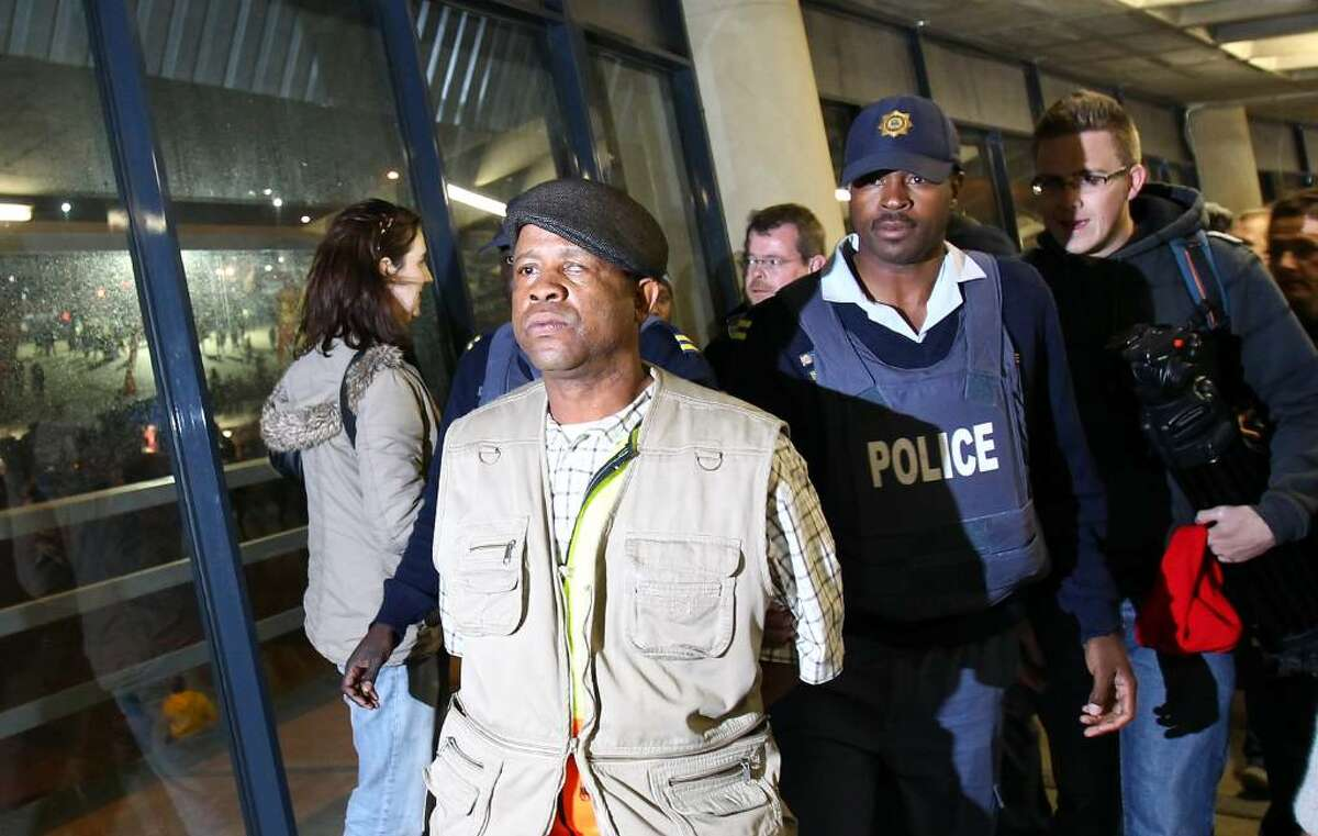 JOHANNESBURG, SOUTH AFRICA - JUNE 10: A man is arrested by the police after caught stealing laptop computers from the press room during the kick-off celebration concert for the 2010 FIFA World Cup at the Orlando Stadium on June 10, 2010 in Soweto, South Africa. (Photy by Martin Rose/GettyImages)