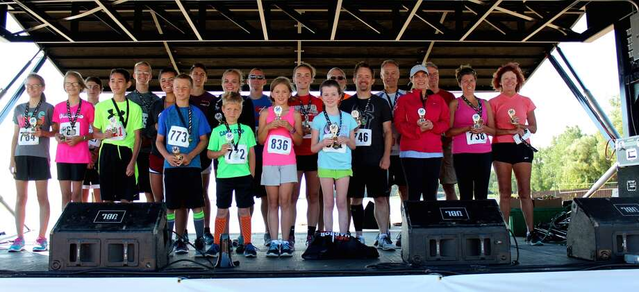p.p1 {margin: 0.0px 0.0px 0.0px 0.0px; text-align: right; line-height: 10.8px; font: 10.0px Helvetica}Pictured are first and second place finishers of the Harbor Beach Community Hospital 5K Run/Walk. (Courtesy Photo)