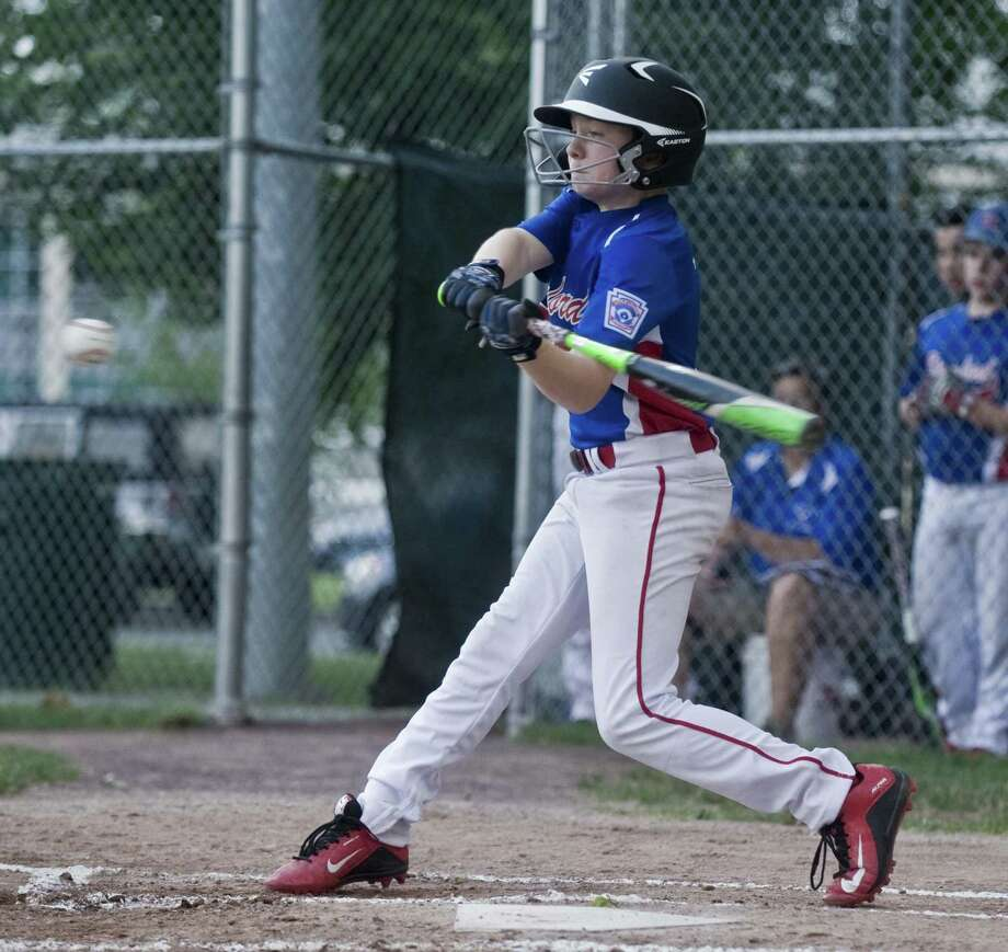 Stamford North's Miles Aquila swings at a pitch during the Little League playoffs against Wilton, played at Scalzi Park in Stamford. Wednesday, July 12, 2017 Photo: Scott Mullin / For Hearst Connecticut Media / The News-Times Freelance