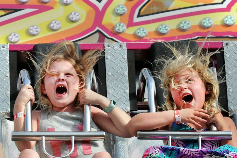 Ellie Hillenbrand, 8, left, and Mia Karish, 6, both of Greenwich, let out screams while on a gravity ride during the St. Catherine of Siena's Carnival of Fun at the church in the Riverside section of Greenwich, Conn., Wednesday, July 12, 2017. The carnival runs through Saturday night at the church that is located at 4 Riverside Avenue. Photo: Bob Luckey Jr. / Hearst Connecticut Media / Greenwich Time