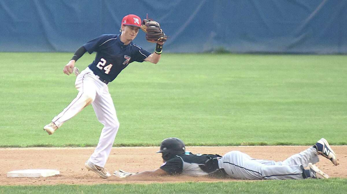 Norwalk second baseman Matt Troy snares the throw as Housatonic Valley baserunner Nick Fleming slides in safely with a stolen base during Wednesday's championship game of the Babe Ruth 18-year-old state tournament at Cubeta Stadium in Stamford. Norwalk won 13-2.