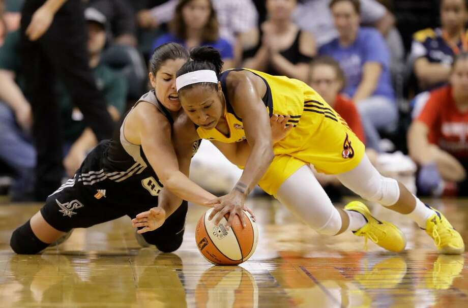 San Antonio Stars' Kelsey Plum, left, and Indiana Fever's Briann January dive for a loose ball during the second half of a WNBA basketball game, Wednesday, July 12, 2017, in Indianapolis. San Antoniodefeated Indiana 79-72. (AP Photo/Darron Cummings) Photo: /