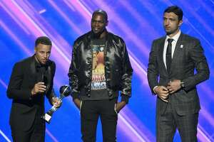 NBA basketball players Stephen Curry, from left, Kevin Durant and Zaza Pachulia, of the Golden State Warriors, accept the award for best team at the ESPYS at the Microsoft Theater on Wednesday, July 12, 2017, in Los Angeles. (Photo by Chris Pizzello/Invision/AP)