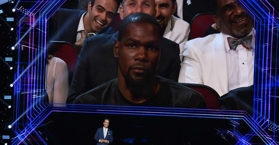 Host Peyton Manning speaks at the ESPYS at the Microsoft Theater on Wednesday, July 12, 2017, in Los Angeles. Pictured on screen is NBA player Kevin Durant, of the Golden State Warriors. (Photo by Chris Pizzello/Invision/AP) Photo: Chris Pizzello/Associated Press