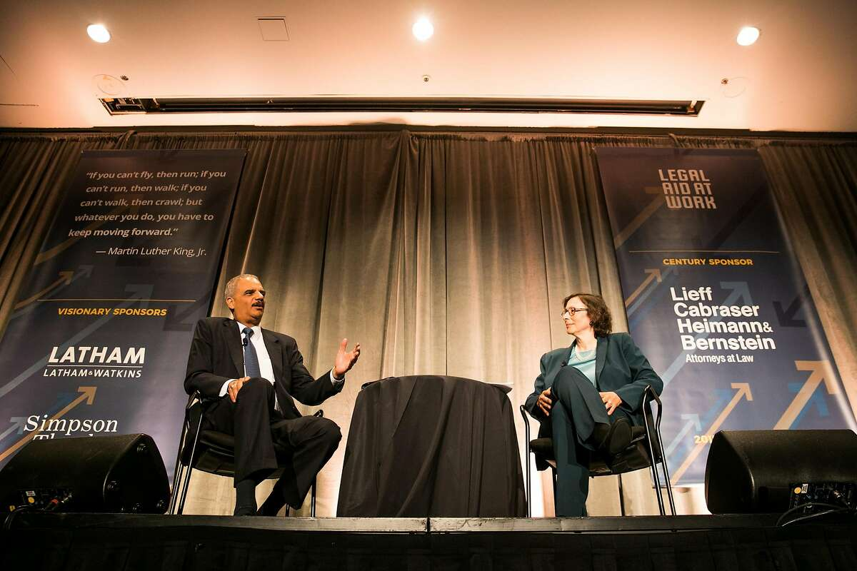 Former U.S. Attorney General Eric Holder talks with Professor of law at Stanford Law School, Pamela S. Karlan, at Legal Aid at Work's 2017 Annual Dinner at the Westin St. Francis in San Francisco, Calif. Wednesday, July 10, 2017.