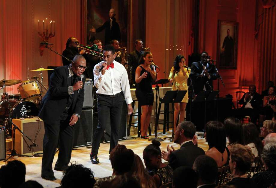 Joshua Ledet, center, performs in April 2013 at the White House in Washington, D.C. (Photo by Martin H. Simon-Pool/Getty Images) Photo: Pool / Getty Images / 2013 Getty Images