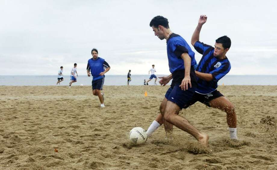 Stamford_091507_The 17th annual Laurel House Move-A-Long Health and Fitness festival featured a soccer tournament where players on four-man teams battled on the beach at Cove Island Park. Andrew Sullivan/Staff photo Staff Photo Andrew Sullivan Photo: ANDREW SULLIVAN / ST / 00004318A