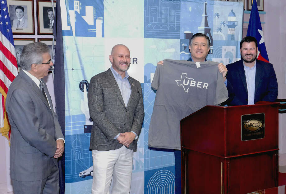 State Representative Richard Peña Raymond, at podium, welcomed UBER to Laredo, Wednesday, July 12, 2017, at a press conference at the Laredo Chamber of Commerce offices. Other present at the event were, from left, Laredo Chamber of Commerce President/CEO, Miguel Conchas; Mayor Pro Tempore, Alejandro Perez Jr., and Uber Government Relations officer, Chris Miller. Photo: Cuate Santos/Laredo Morning Times