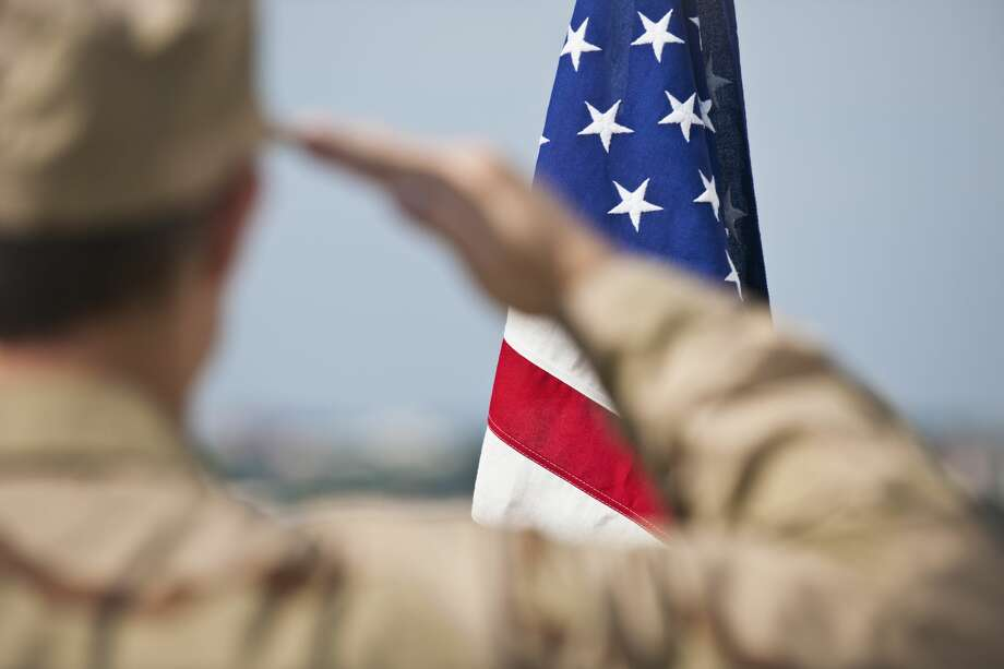 According to Fox News this week Erin Hester from Vine Grove, Kentucky was able to snap a photo a soldier saluting a funeral procession as it drove through that town, just south of Fort Knox, in a punishing rainstorm. Click through to see which celebrities served in the military... Photo: Tetra Images/Getty Images/Tetra Images RF