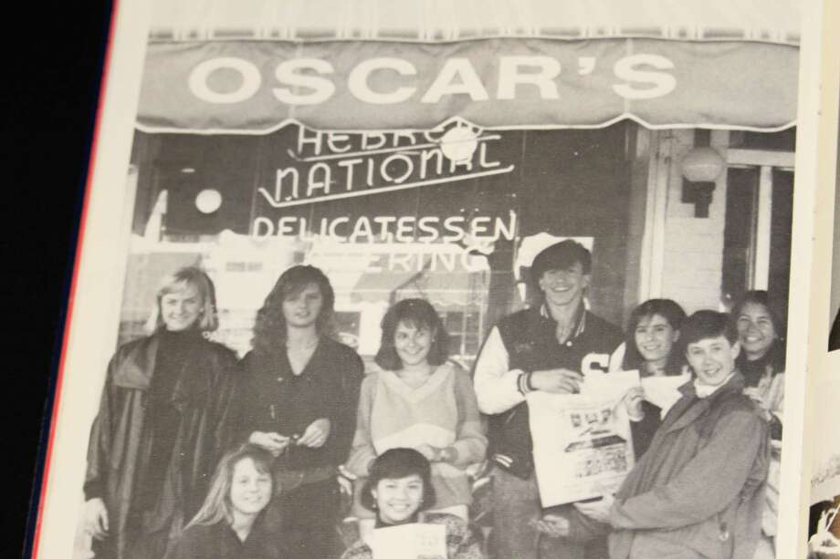 The Staples class of 1987 poses for a picture outside of Oscar's. The deli closed in 2016. Photo: Contributed Photo / Westport News