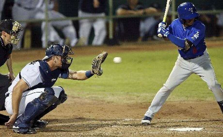 San Antonio Missions' Griff Erickson catches as Tulsa Drillers' Ronald Torreyes bats July 11, 2015 at Nelson W. Wolff Municipal Stadium. Photo: Staff Photo /