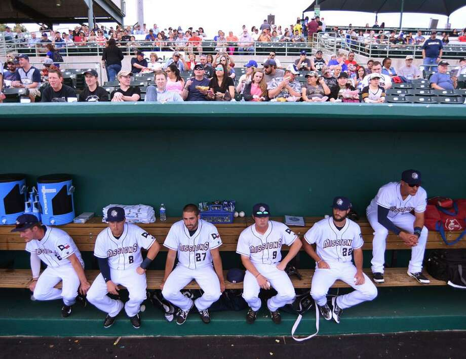 The San Antonio Missions relax in their dugout before taking on the Springfield Cardinals in their 2016 home opener at Nelson Wolff Stadium on Thursday, April 7, 2016. Photo: Staff Photo /