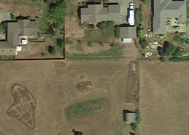 Google Earth reveals neighbor's insult carved into the grass