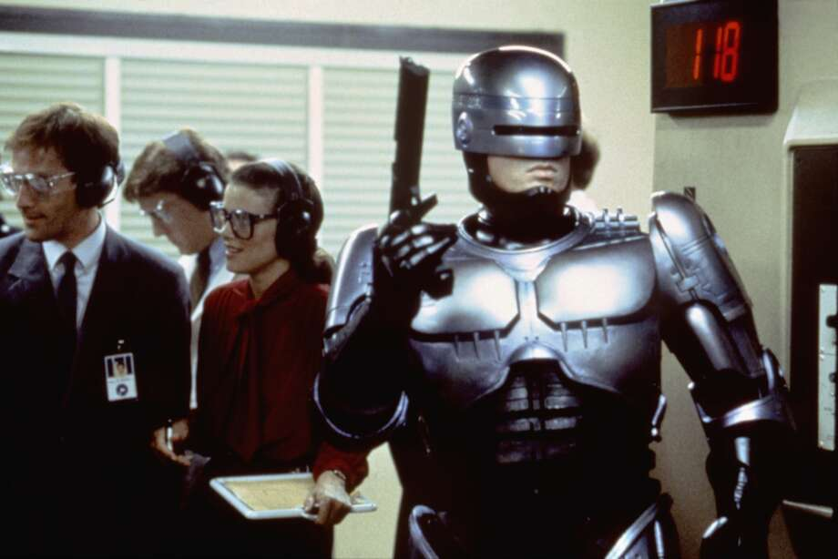"ROBOFACTS: ""Robocop"" turns 30 The gory, dystopian satire ""Robocop"" debuted in theaters this week in 1987. It was almost immediately an R-rated box office hit and a pop-culture phenomenon was born in the process. Click through to learn more about the first film in the ""Robocop"" series... Photo: Sunset Boulevard/Corbis Via Getty Images"