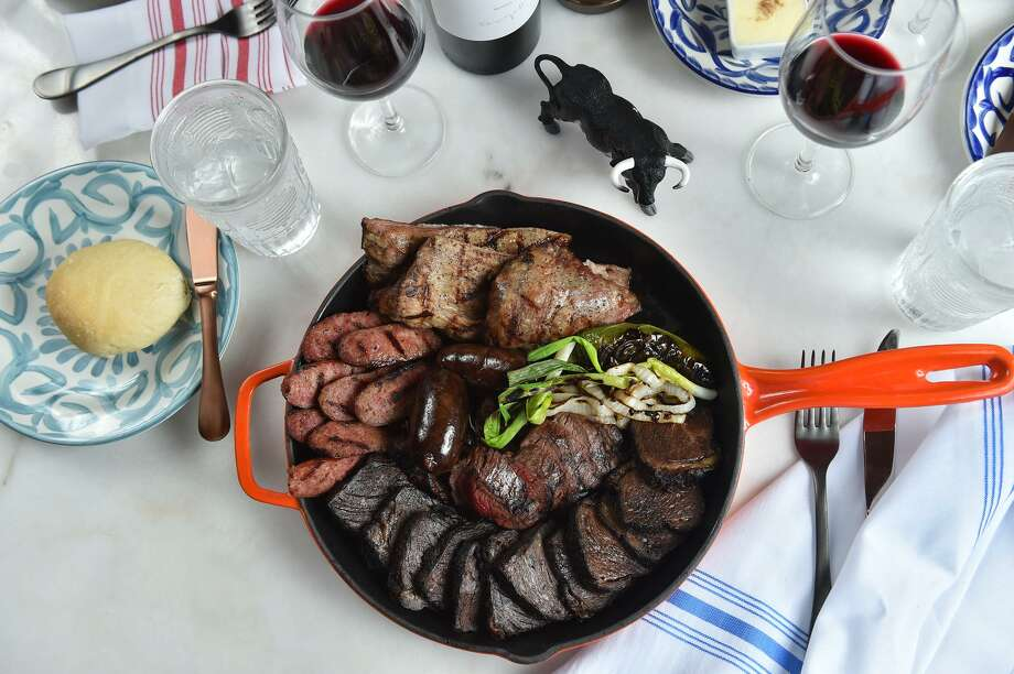 The Argentine Parrillada at Dorrego's includes grilled chorizo, blood sausage, Ibérico pork, smoked short rib and Wagyu beef shoulder. Photo: Robin Jerstad / For The Express-News / ROBERT JERSTAD