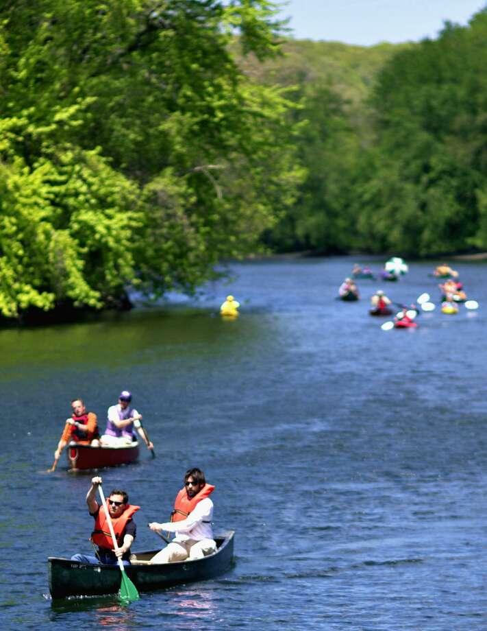 File photo of canoes on the Housatonic River near Young's Field and Veterans Memorial Bridge in New Milford. Photo: Trish Haldin / Trish Haldin / Trish Haldin