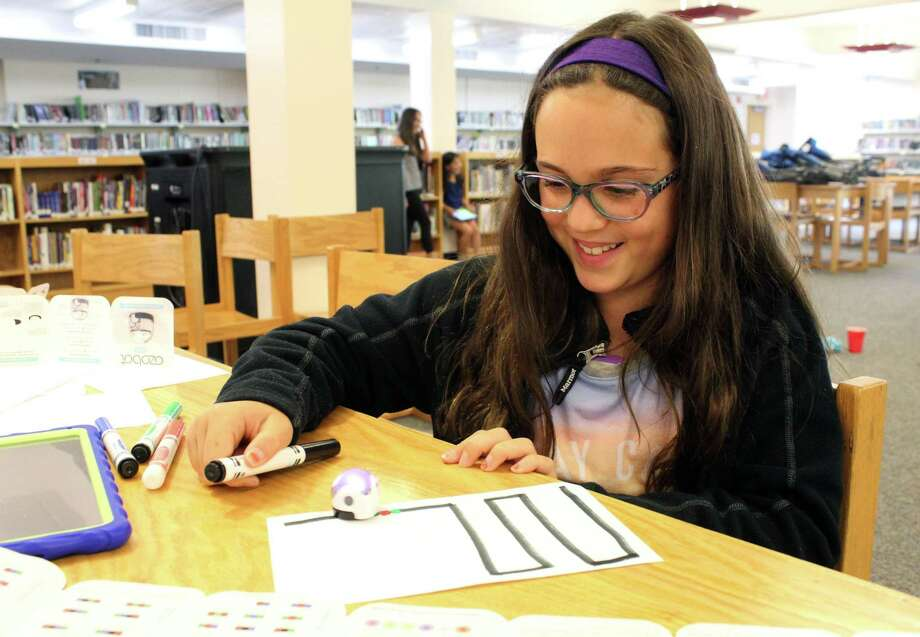 Sarah Albanese, 10, watches as Ozobot follows the commands of her coding at Wilton Continuing Education's coding, robotics and maker crafts summer camp on Wednesday, July 12, 2017. Photo: Stephanie Kim / Hearst Connecticut Media