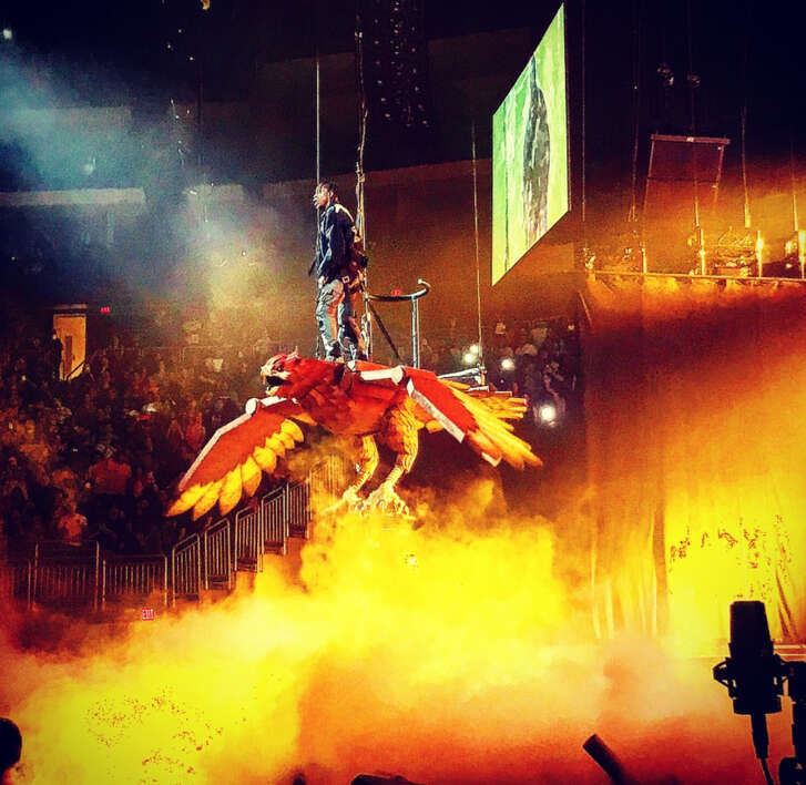 Houston native Travis Scott flew on an animatronic bird on the first stop of his tour with Kendrick Lamar in Phoenix.