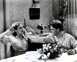James Cagney smashes a grapefruit in Mae Clarke's scene, from the infamous scene in THE PUBLIC ENEMY (1931, William Wellman).