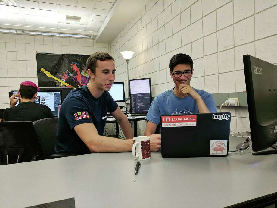 Ithaca College Summer Scholar and Fairfield native Jonathan Burger, right, works with fellow student David Dorsey on MegsRadio, an Internet radio app that suggests local music. Photo: Jonathan Burger / Contributed Photo / Fairfield Citizen