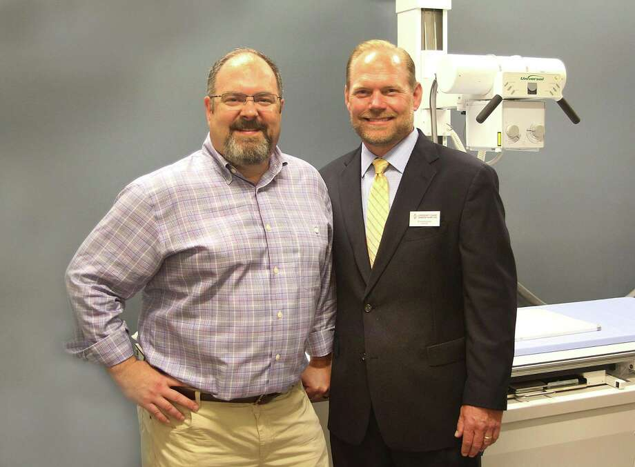 Tom Kelly, left, and Ron Krippner, co-owners of six AFC Urgent Care locations, including three in Danbury, in the X-ray room of their latest location on Newtown Road on Wednesday. Photo: Chris Bosak / Hearst Connecticut Media / The News-Times