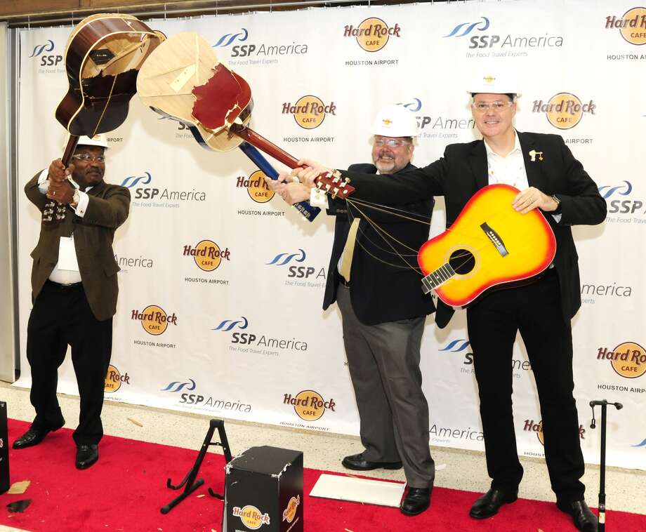 Officials from Hard Rock, the Houston Airport System and SSP America smashed guitars at the grand opening at Bush Airport July 12, 2017.