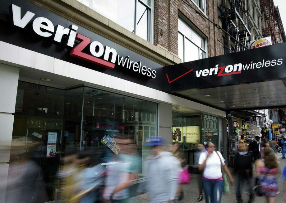 Pedestrians pass a Verizon Wireless store on Canal Street in New York. Verizon confirmed Wednesday that data belonging to 6 million customers was leaked online in June. Photo: Associated Press File Photo / FR170537 AP