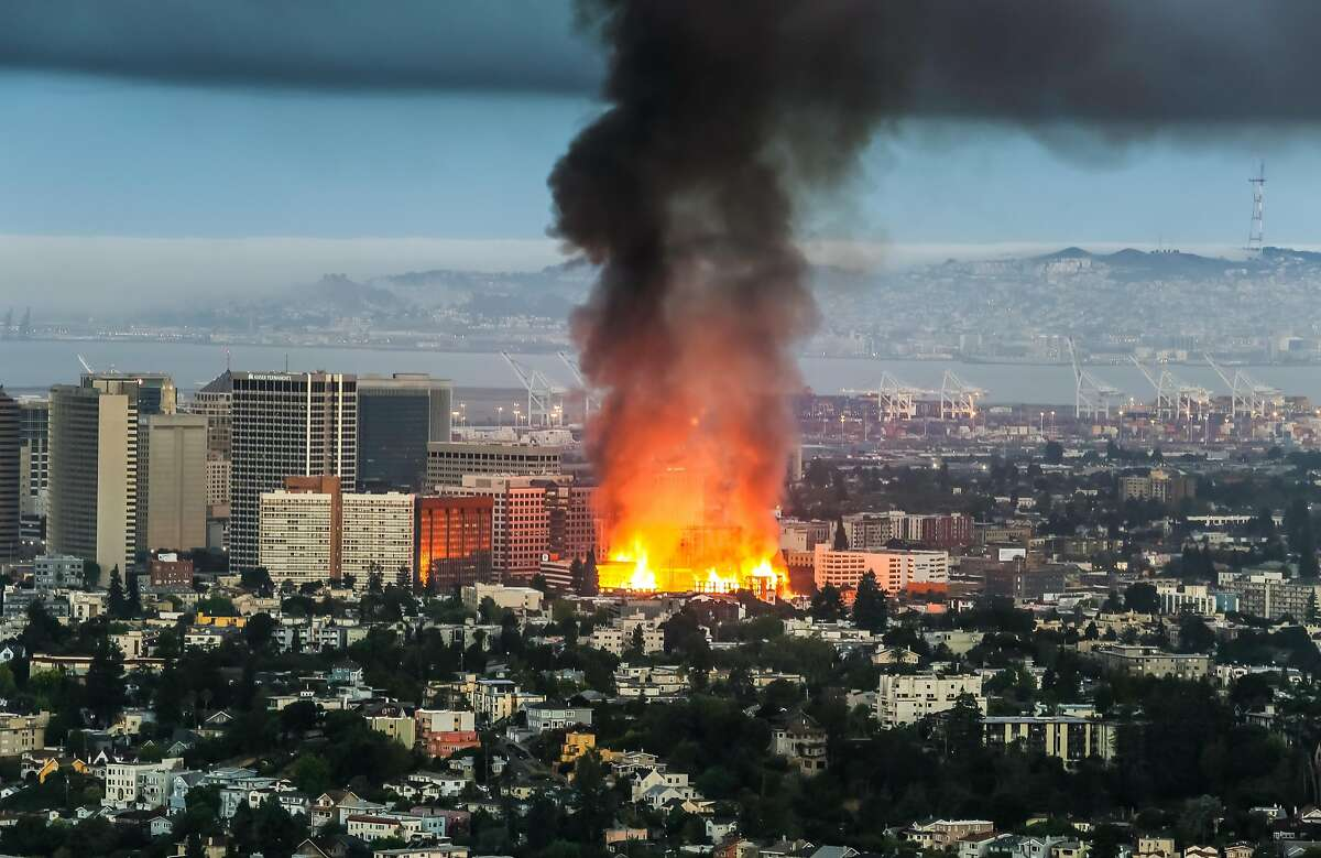 A massive fire at a downtown Oakland construction site as seen from the Oakland Hills on July 7, 2017 at approximately 5:25 am PST.
