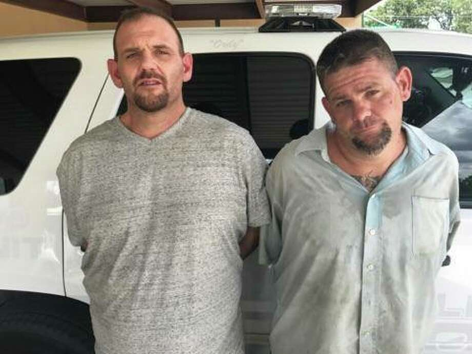 Phillip Fraley, 38, and Timothy Fraley, 34, are charged with possession of a controlled substance in Montgomery County after a July 8 traffic stop allegedly revealed cocaine and firearms in their vehicle.  Photo: Splendora Police Department
