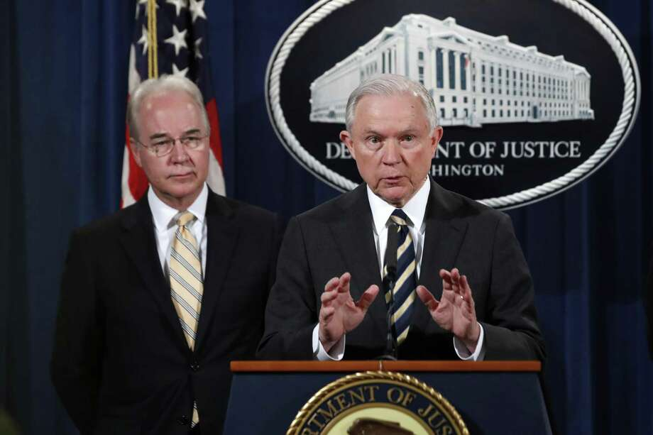 Attorney General Jeff Sessions, right, with Health and Human Services Secretary Tom Price, speaks about opioid addiction during a news conference, Thursday, July 13, 2017, at the Justice Department in Washington. (AP Photo/Jacquelyn Martin) Photo: Jacquelyn Martin, STF / Associated Press / Copyright 2017 The Associated Press. All rights reserved.