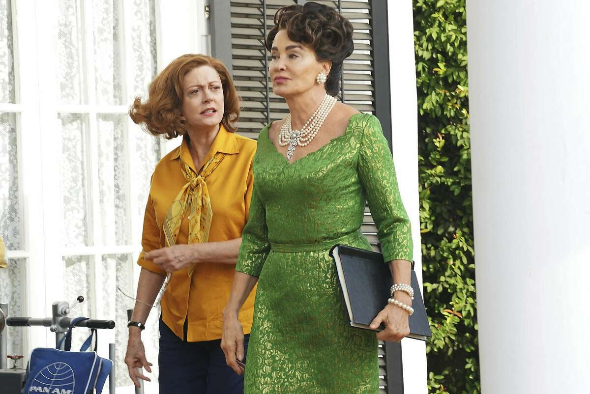 This image released by FX shows Susan Sarandon as Bette Davis, left, and Jessica Lange as Joan Crawford in