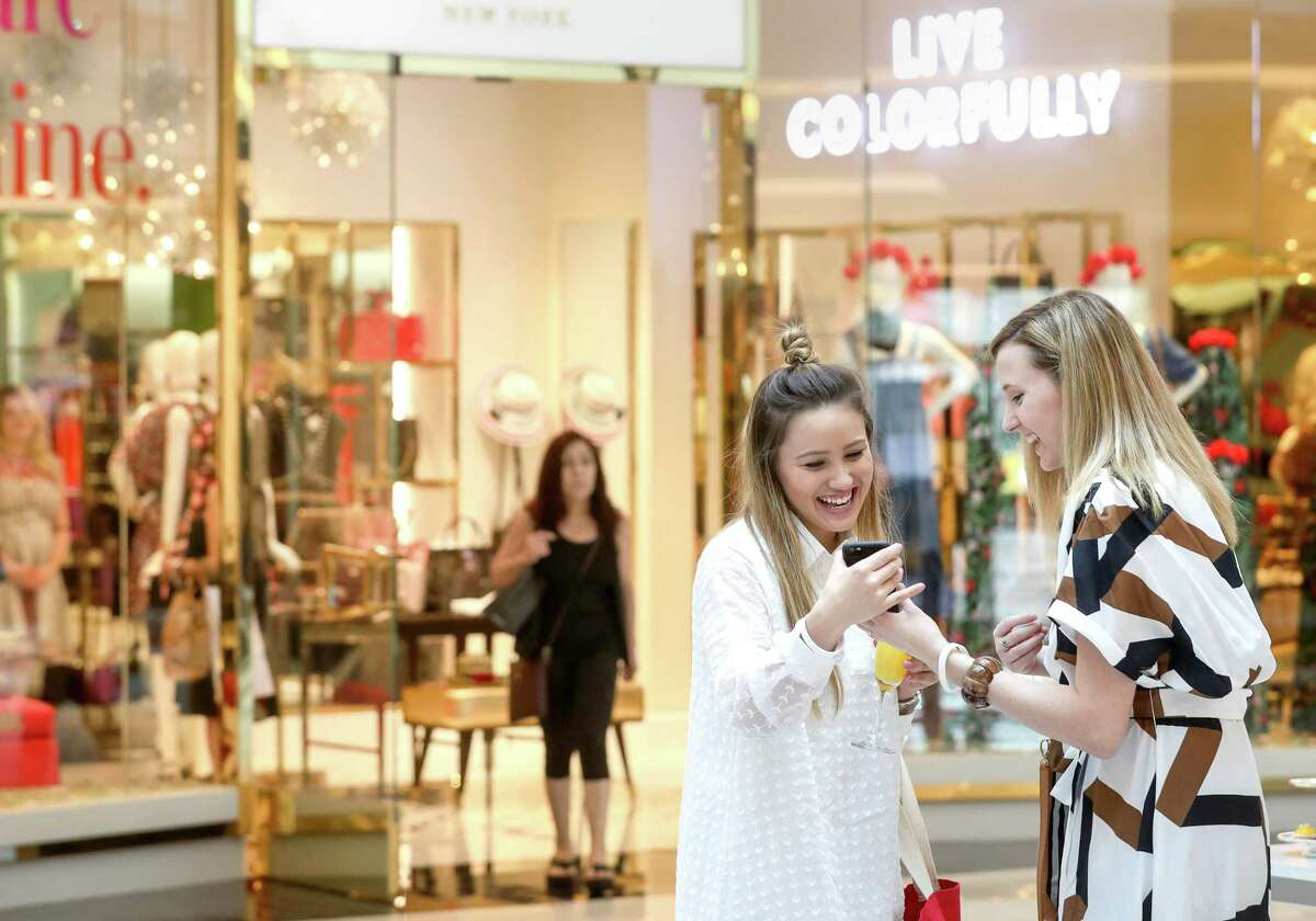 """Kristine Pagel, center, laughs with Haley Freytag, right, during an event to celebrate the opening of a remodeled luxury wing at the Galleria Thursday, July 13, 2017, in Houston. """"You get a lot of stores in one location, and the hands on feeling,"""" Freytag said. """"It's that instant gratification."""" ( Jon Shapley / Houston Chronicle )"""