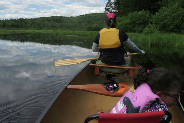 Gillian Scott and her foster daughter paddle the quiet waters of Alder Creek. (Herb Terns / Times Union)