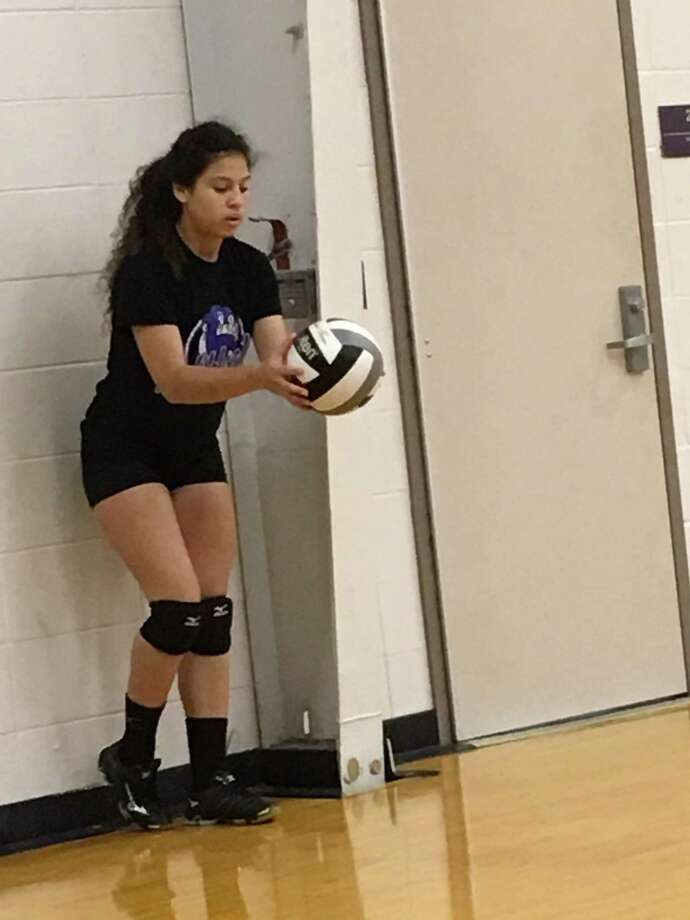 Humble rising senior defensive specialist Jennifer Peralta prepares to serve during a practice game at the Humble volleyball open gym that was held at the school on Monday, July 10 Photo: Elliott Lapin