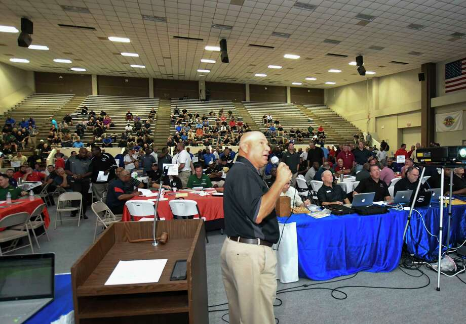 The Houston chapter of the Texas Association of Sports Officials (TASO) held its annual Officials Draft Tuesday at Phillips Field House, adjacent to Pasadena Memorial Stadium. Relying primarily on their memories of the officiating crews over the last few years, coaches drafted the crews for their 10 regular-season varsity games, more than 1,100 events over the course of Tuesday's two drafts. Photo: Tony Gaines / HCN