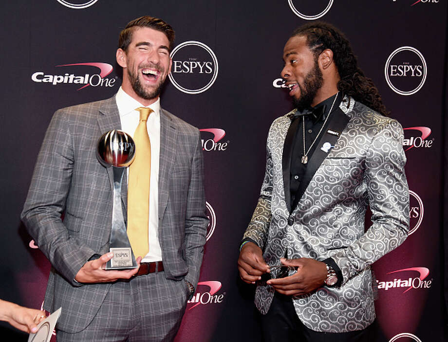 LOS ANGELES, CA - JULY 12:  Olympic swimmer Michael Phelps (L), winner of the Best Record-Breaking Performance award, and NFL player Richard Sherman attend The 2017 ESPYS at Microsoft Theater on July 12, 2017 in Los Angeles, California.  (Photo by Kevin Mazur/Getty Images) Photo: Kevin Mazur/Getty Images