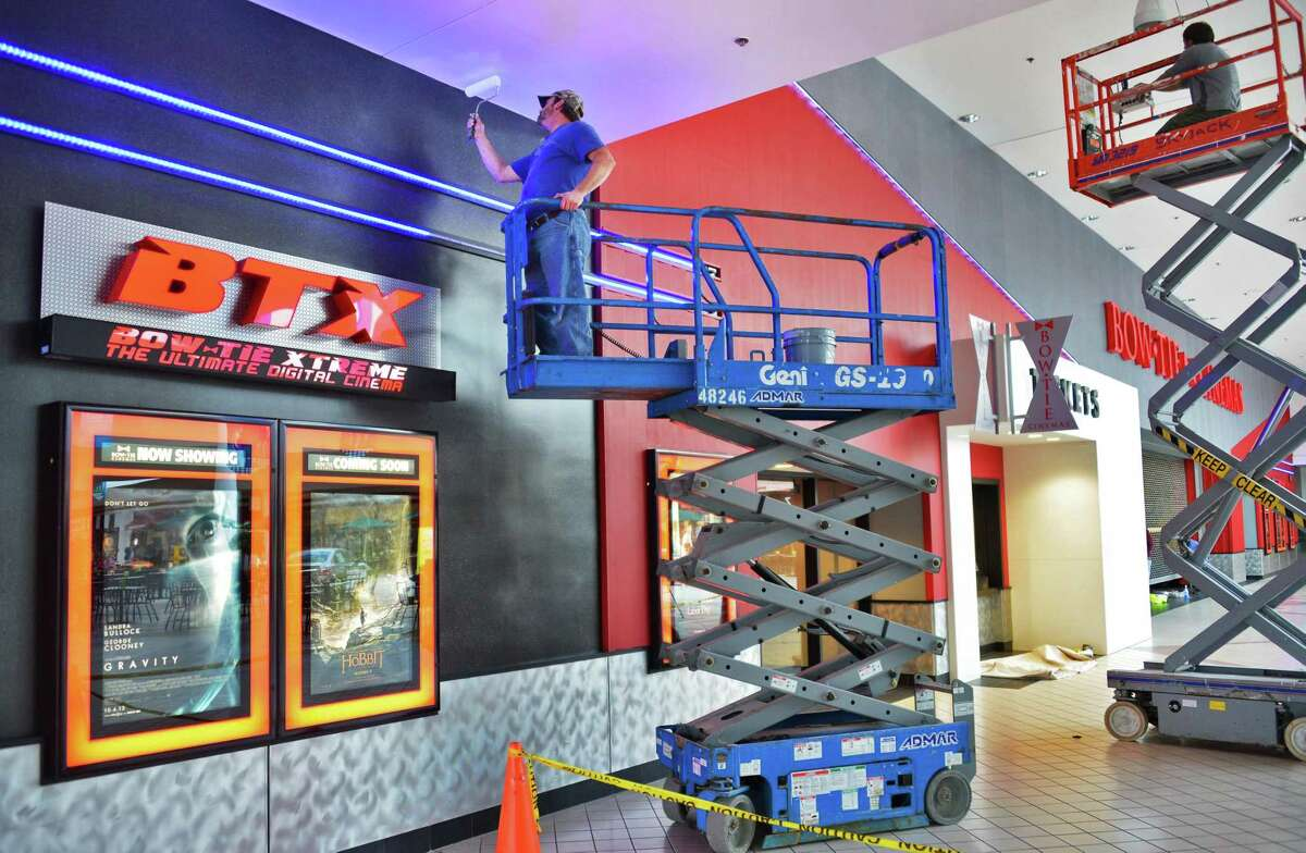 Workers apply finishing touches outside the new Bow Tie Cinemas at Wilton Mall Thursday Oct. 24, 2013, for tonight's grand opening in Saratoga Springs, NY. (John Carl D'Annibale / Times Union)