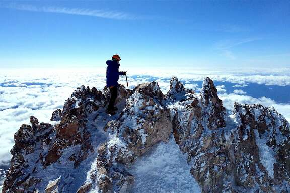 Ryan Ghelfi on the 14,179-foot summit of Mount Shasta in Northern California. The summit is a lava plug dome crag. The climb is 7-miles one-way with a climb of 7,000 feet, one of America's greatest mountain climbs that most in good fitness can attempt.