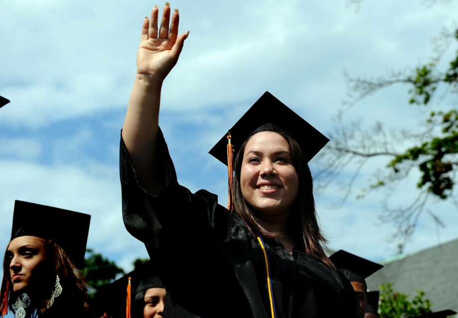 Graduate Cynthia Torres waves to her mother at the start of the 2010 Bullard-Havens Technical High School graduation ceremony Thursday June 10 at Klein Memorial Auditorium in Bridgeport. Photo: Autumn Driscoll / Connecticut Post